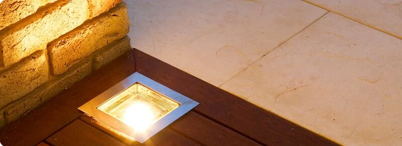 Combination of timber deck, lighting & Castlestone paving