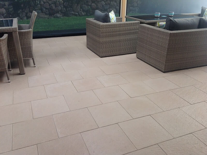 Castlestone paving in alfresco space with sofas in complementry shades