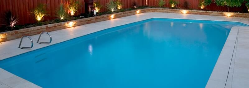 Renovation of older pools with Castlestone limestone capping & paving creates new look