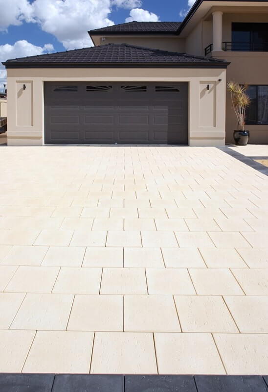Castlestone in Reef Natural driveway with charcoal full paver as border