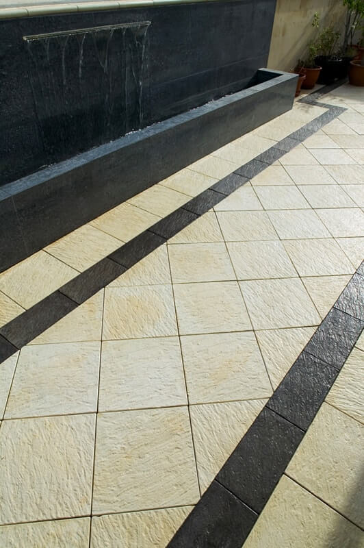 Diamond pattern laid pavers with Castlestone Beach Charcoal Standard Border