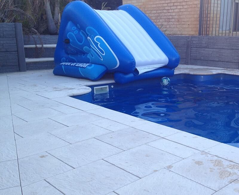 Castlestone paving around Buccaneer Pool with Large external corner